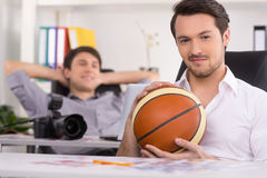 Man with basketball ball on the foreground. Royalty Free Stock Images