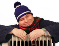 Man Basking In The Heater. Stock Photos