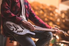 Man with a bass guitar. In the store stock photography