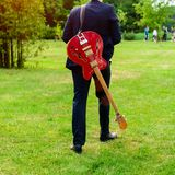 Man with a bass guitar outdoor stock photos