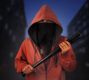 Man with bat outdoor Stock Image