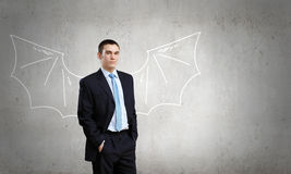 Man with bat wings Royalty Free Stock Photo