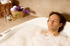 Man in bath Stock Photography
