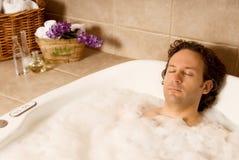 Man in bath stock photography
