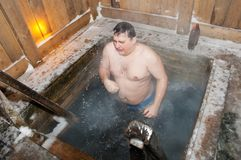 The man bathes in an ice-hole royalty free stock photography