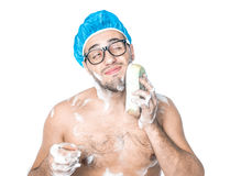 Man bathing in a bathroom Royalty Free Stock Image