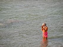 Man bathing in the Ganges at Rishikesh Royalty Free Stock Photo