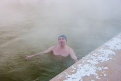 Man bathing in the hot springs, the city of Tyumen Stock Photo