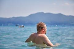 Man bathing in lake Atterse Stock Photo