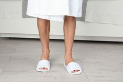 Man in bathing slippers. On wooden floor Royalty Free Stock Photos