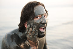 Man in a bathing suit of natural mineral mud Stock Images