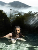 Man bathing in tropical waters Royalty Free Stock Photography