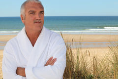 Man in bathrobe Stock Photography