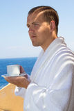 Man in bathrobe with cup of coffee Stock Photography