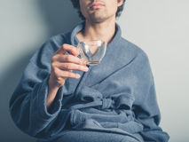 Man in bathrobe with empty cup using tablet Royalty Free Stock Photo