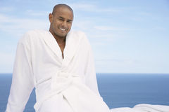 Man In Bathrobe With Ocean In Background Stock Photography