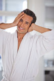 Man in a bathrobe. Smiling and looking at the camera Stock Photo