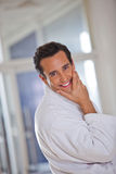Man in a bathrobe. Smiling and looking at the camera Stock Image