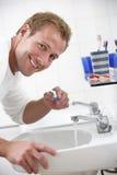 Man In Bathroom Brushing Teeth Royalty Free Stock Image