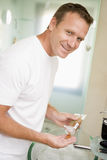 Man in bathroom with hair gel Royalty Free Stock Photography