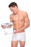 Man with bathroom scales Royalty Free Stock Images