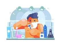 Man in bathroom shaves Royalty Free Stock Photo