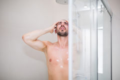 Man in bathroom at the shower Stock Photos