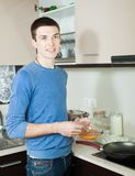 Man with batter and skillet Stock Photography