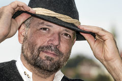 Man with a Bavarian black hat Royalty Free Stock Image
