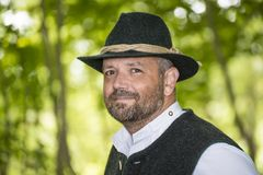 Man with Bavarian traditional black hat Royalty Free Stock Images