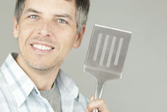 Man With BBQ Flipper Stock Photo