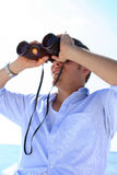 Man on Beach. With binoculars in his hand Stock Photography