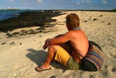 Man on Beach. Small island in the harbor of Puerto Villamill, Isla Isabella, Galapagos Islands Royalty Free Stock Photography