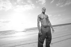 Man on the beach. Handsoem young man on the beach. Image in black and white Royalty Free Stock Images