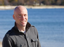 Man at beach. Happy handsome man at beach smiling portrait Royalty Free Stock Photo