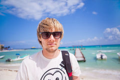 Man on the beach. Portrait of a young man santing on the beach Stock Photo