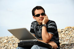 Man on the beach. With laptop Royalty Free Stock Image