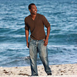 Man on the beach. Young male model in a beach scene Royalty Free Stock Photo