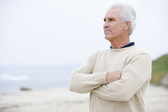 Man at the beach with arms crossed Royalty Free Stock Images
