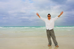 Man On Beach With Arms Extended Royalty Free Stock Photo