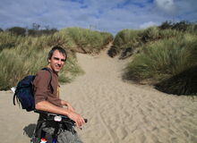 Man on beach with bike stock photos