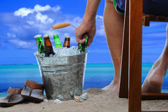 Man at the Beach with a Bucket of Beer Stock Photo