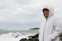 Man at the beach on a cold day Royalty Free Stock Photos