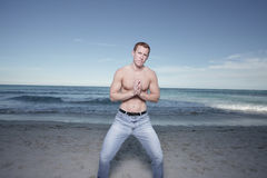 Man on the beach with hands clasped Royalty Free Stock Photo