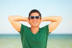 Man at the beach Stock Image
