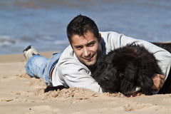 Man on the beach with his dog Stock Photos