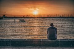 A man by the beach. I stumbled across this guy who's spacing out by himself at a beach in Melbourne Stock Images