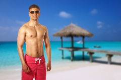 Man on beach with jetty. At Maldives. Collage Royalty Free Stock Images