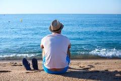 Man on beach, Lioret de Mar, Spain stock photography