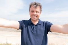 Man on the beach make phone camera selfie royalty free stock photos